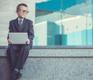 kid businessman with laptop