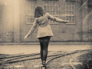 girl walking on the railway, retro stylized photo
